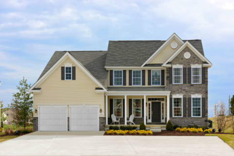 Colonial two story home with two car garage – brick & wood paneled exterior