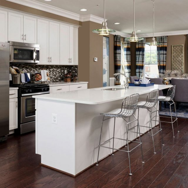 Photo of a modern kitchen with island breakfast bar